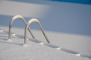 Snowy swimming pool stairs in the winter