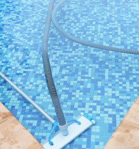 Swimming pool cleaning tools in the bottom.