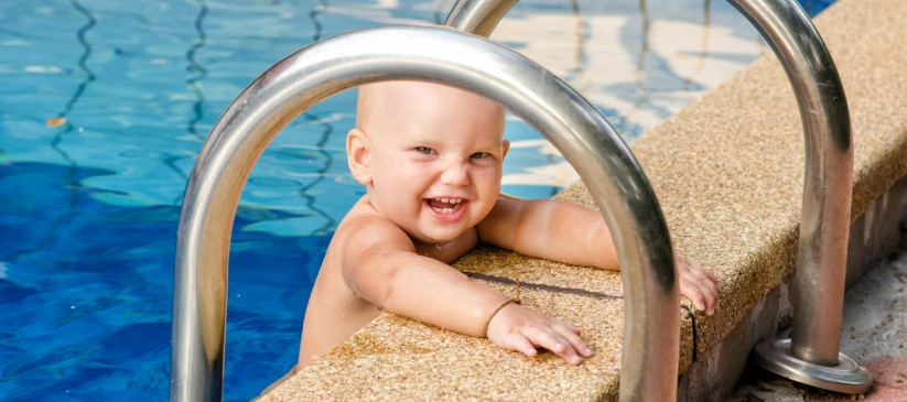Little child on the swimming pool